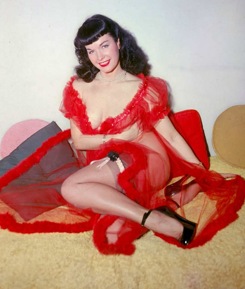 Here is Bettie in a Red neglige and heels on a bed with cute plush pillows. I purchased the same colors and felt like an instant Bettie!